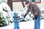Grandfather and toddler boy  on winter day — Stock Photo