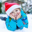 Happy little toddler boy waiting for Christmas santa hat — Stock Photo #53755687