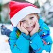 Happy little toddler boy waiting for Christmas santa hat — Stock Photo #53755721
