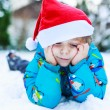 Happy little toddler boy waiting for Christmas santa hat — Stock Photo #53755765