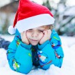 Happy little toddler boy waiting for Christmas santa hat — Stock Photo #53755821