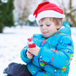 Happy little toddler boy waiting for Christmas santa hat — Stock Photo #53755827
