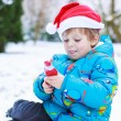 Happy little toddler boy waiting for Christmas santa hat — Stock Photo #53755845