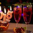 Two glasses with red champagne and candles 2015 — Stock Photo #53759487