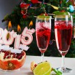 Two glasses with red champagne and candles 2015 — Stock Photo #53759623