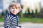 Portrait of toddler boy having fun on outdoor playground — Stock Photo