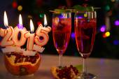 Two glasses with red champagne and candles 2015 — Стоковое фото