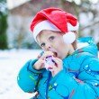 Happy little toddler boy waiting for Christmas santa hat — Stock Photo #55577777