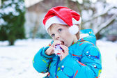 Happy little toddler boy waiting for Christmas santa hat — Stockfoto