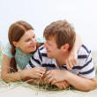 Young happy couple in love having fun on sand dunes of the beach — Stock Photo #55580327