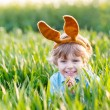 Funny kid boy of 3 years with Easter bunny ears, celebrating Eas — Stock Photo #56403855