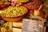 Marinated garlic and olives on provencal street market in Proven — Stock Photo