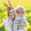 Little toddler boy and his mother in Easter bunny ears having fu — Stock Photo #57124607