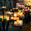 Church candles in red, green, blue and yellow transparent chande — Stockfoto #58153937