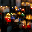 Church candles in red, green, blue and yellow transparent chande — Stockfoto #58153957