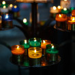 Church candles in red, green, blue and yellow transparent chande — Stock Photo #58153961