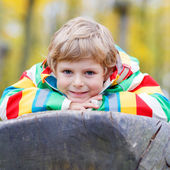 Little kid boy having fun on autumn playground — Stock Photo