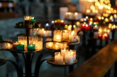 Church candles in red, green, blue and yellow transparent chande — Stock Photo