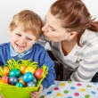 Little boy and his mother being happy about selfmade Easter eggs — Stock Photo #60635013