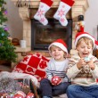 Two little sibling boys playing with christmas toys — Stock Photo #60635659