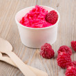 Frozen creamy ice yoghurt  with whole raspberries — Fotografia Stock  #60636617