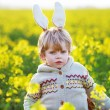 Funny boy of 3 years with Easter bunny ears, celebrating Easter — Stock Photo #60637791