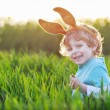 Funny boy of 3 years with Easter bunny ears, celebrating Easter — Stock Photo #60638041