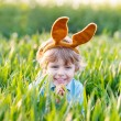 Funny kid boy of 3 years with Easter bunny ears, celebrating Eas — Stock Photo #60638117