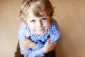 Portrait of adorable little boy with blond hairs and blue eyes — Stock Photo
