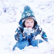 Adorable toddler boy having fun with snow on winter day  — Stock Photo #61784575