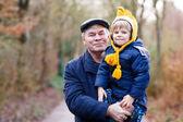 Happy grandfather with his grandchild on arm — Stock Photo