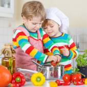 Two cute little kid boys cooking italian soup and meal with fres — Stock Photo