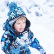 Adorable toddler boy having fun with snow on winter day  — Stock Photo #62669921