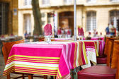 Street view of a cafe terrace with empty tables and chairs, Prov — Stock Photo