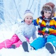 Portrait of little girl and boy in winter hat in snow forest at — Stock Photo #64900277