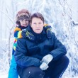 Portrait of a little kid boy and his young father in in snow for — Stock Photo #64900325