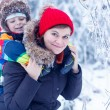 Portrait of a little boy and his mother in winter hat in snow fo — Stock Photo #64900329