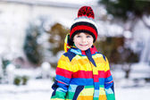 Portrait of little boy in colorful clothes in winter, outdoors  — Stock Photo