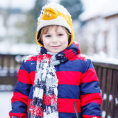 Portrait of little child in colorful clothes in winter, outdoors — Stock Photo