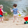 Little toddler boy and girl playing together with sand toys near — Stock Photo #68681479