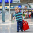 Little boy going on vacations trip with suitcase at airport — Stock Photo #68686039