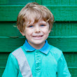 Portrait of happy little cute kid boy with blond hairs and blue  — Stock Photo #71064059