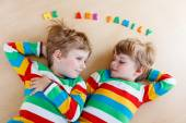 Two little sibling kid boys having fun together, indoors — Stock Photo