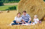 Mother, father and little son, kid boy having picnic — Stock Photo