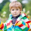 Little blond boy with lot of wild flowers — Stock Photo #75871759
