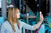 Girl making a selfie with her smartphone — Stock Photo