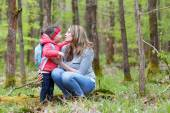 Mother and child outdoors playing, kissing and hugging — Stock Photo