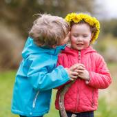 Little girl and boy playing together in forest — Stock Photo
