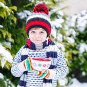 Funny little child holding big cup with snowflakes and hot choco — Stock Photo