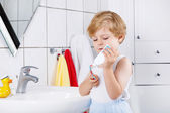 Lovely toddler boy brushing his teeth, indoors — Stock Photo